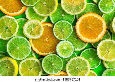 Citrus fruits slices pattern texture background, lime, lemon and oranges flat lay