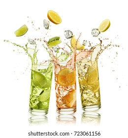 citrus fruits soft drink with fruit slices and ice cubes falling and splashing, on white background