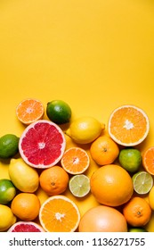 Citrus fuits, grapefruit, lemon, lime, orange on a yellow background