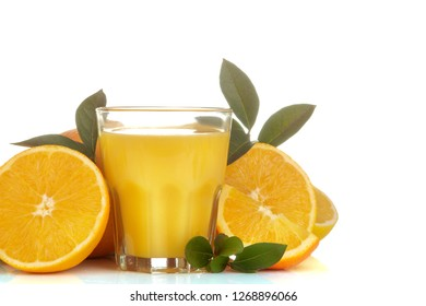 Citrus juices. orange juice in a glass with fresh fruit on a white isolated background