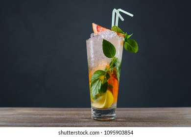 Citrus lemonade with grapefruit and basil, refreshing cold iced drink. Healthy lifestyle, summer delightful beverage, cocktail, bar concept