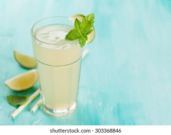 Citrus lemonade with lime and mint, selective focus