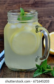 Citrus lemonade with mint in mason jar on table
