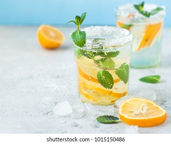 Citrus lemonade water with lemon sliced healthy and detox water drink in summer on  blue lighten background