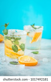 Citrus lemonade water with lemon sliced healthy and detox drink in summer on  blue lighten background