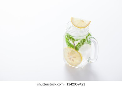Citrus lemonade water with lemon sliced , healthy and detox water drink in summer on white table