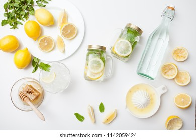 Citrus linfused emonade water with lemon sliced , healthy and detox water drink in summer on white table. Health care, fitness, diet concept.