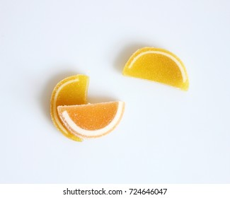 Citrus marmalade on the white background. Isolated. Top view. Useful healthy food. Assorted candies marmalade. Sweets. Organic food. Pattern. Dessert.