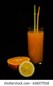 Citrus orange juice on a black background