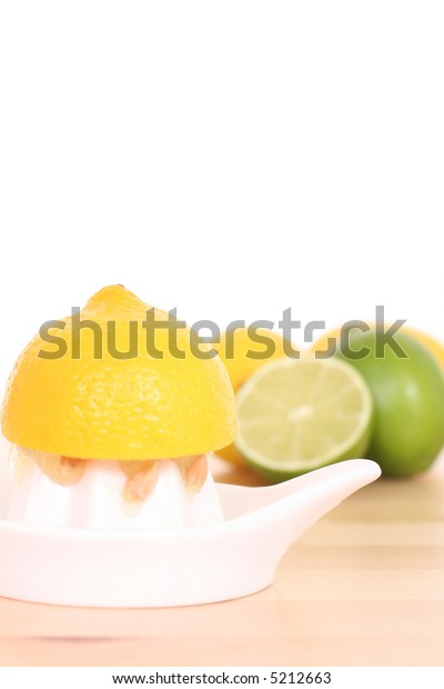 citrus squeezer and some fresh lemon and lime