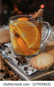Citrus tea with cinnamon and cardomom in a glass. With sweet hom