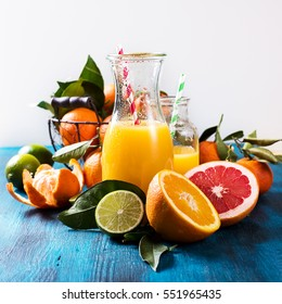 Citrus vitamin juice, healthy drink with fresh fruits, lime, grapefruit, orange, tangerine. Refreshing homemade lemonade. Breakfast beverage