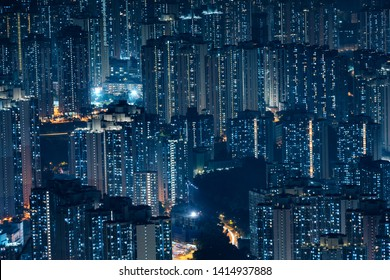 City Aerial view skyscrapers office lighting and Blinking light in apartments - Nighttime skyline City of a big modern building