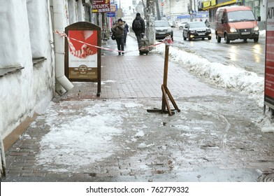 City after blizzard. Dangerous stretch of street marked by ribbons because of ice covering. January 12, 2016. Kyiv, Ukraine.