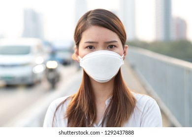 City air pollution concept. Close up woman wearing N95 mask to protect pm2.5 air pollution in city