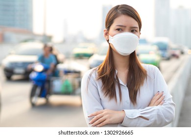 City air pollution concept. Close up woman wearing  mask to protect air pollution in city