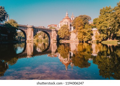 The city of Amarante bathed by the river Tâmega and the monastery and bridge of São Gonçalo as background during a morning.