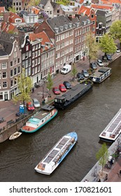 City of Amsterdam from above, Prinsengracht street, cruise boat and houseboats on a canal, Holland, the Netherlands.