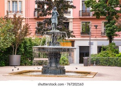 The city of Annecy. Historic city square and an ancient fountain in the resort tourist town of Annecy in France.