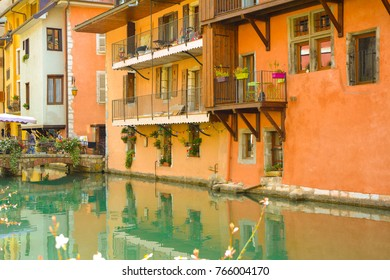 The city of Annecy. Historical medieval houses and a canal, embankment with flowers and bridges in the resort town of Annecy in France in the summer.