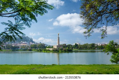 City of Antananarivo at sunny day with monument in the center of lake Anosy. Madagascar
