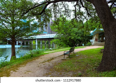 City of Austin has beautiful parks with walking trails, paths, park benches, large oak shade trees, along the river downtown Austin TX