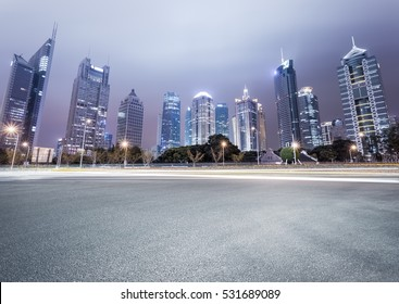 city avenue with modern buildings at night in shanghai financial and trade zone
