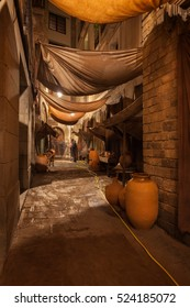 City of Barcelona by night in Catalonia, Spain, Old Town, Gothic Quarter (Barri Gotic), narrow alley with traditional pottery shops
