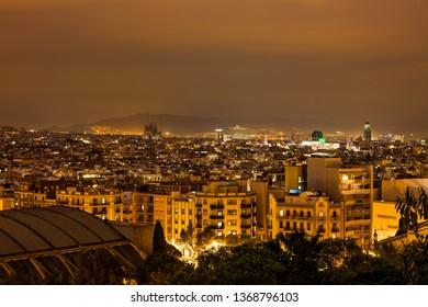 City of Barcelona sepia tone night cityscape from Poble Sec district, Catalonia, Spain
