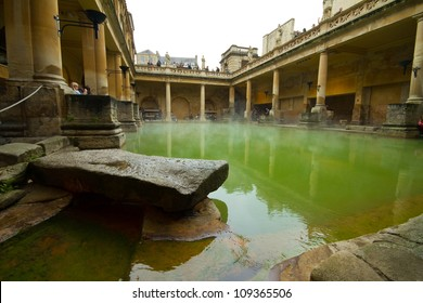 CITY OF BATH, ENGLAND - APR 20: Tourists at the ancient Roman Bath Museum, West England, Apr 20, 2012. City of Bath receives 4.5M visitors from many countries per year.