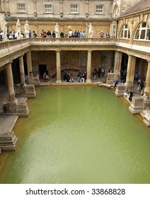 CITY OF BATH, ENGLAND - JULY 6: Tourists at the ancient Roman Bath Museum, West England, July 6, 2009. The Baths are a major tourist attraction and receive more than one million visitors a year.