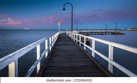 city beach sunrise wooden pier Port Melbourne coastal bay cityscape early morning calm