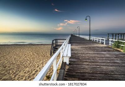 city beach wooden pier Melbourne calm bay summer morning