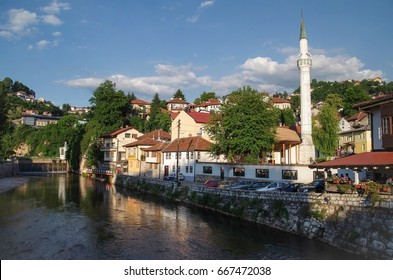 The city in beams of the evening sun. View of the Sarajevo with cloudy evening sky from the Miljacka River.  Bosnia and Herzegovina, Sarajevo