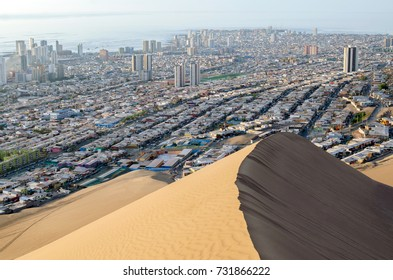 city behind sand dune
