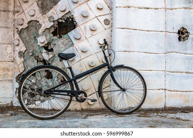 City bicycle on Grey wall. Cycling or commuting in city urban.