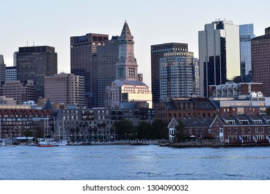 City of Boston Massachusetts skyline view from water at sundown