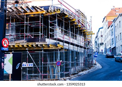 City of Brussels, Belgium, November 2018 Iron Beams and Steel Bar Scaffolding on the Building Exterior. Unfinished Two Level Structure still Under Construction. Traffic Rules in the Premises Area.