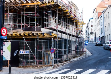 City of Brussels, Belgium, November 2018 Unfinished Building still Under Construction. Steel Bars and Iron Beams Supporting the Structure Exterior. Traffic Rules Scattered in the Surrounding Area.