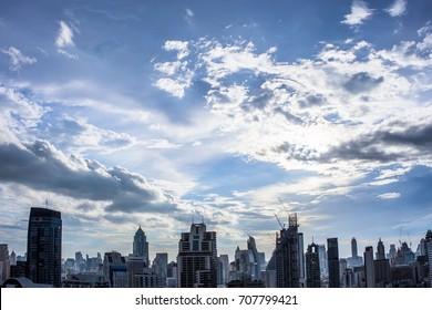 city building with beautiful shining cloud