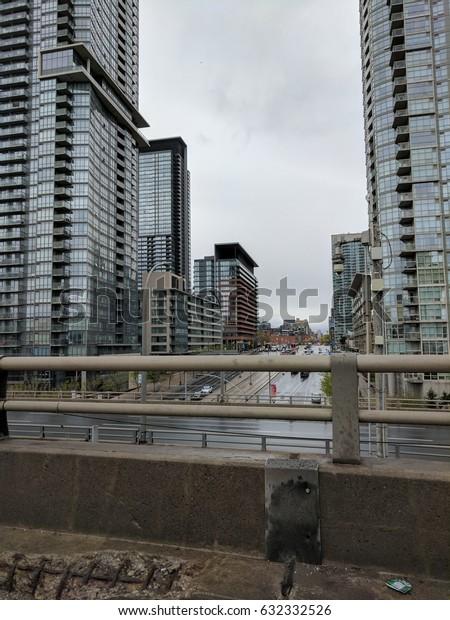 city buildings in the rain