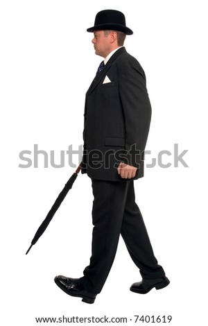 0af3a2242a6 City businessman in pin striped suit wearing a bowler hat and carrying an  umbrella as he