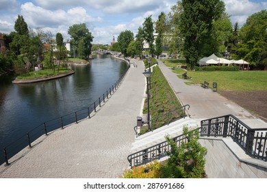 City of Bydgoszcz in Poland, Brda River promenade and alley in a park.