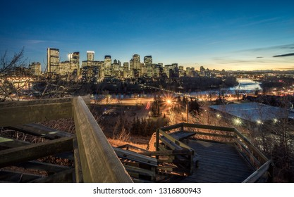 City of Calgary at autumn night with woody stairs at foreground, Canada
