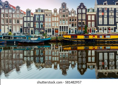 City Canal with glowing lights early in the morning. Amsterdam. Netherlands.