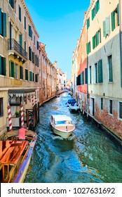 City canal in Venice and the boats on it. Italy.