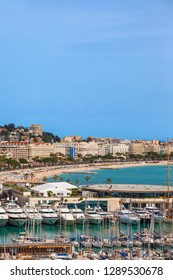 City of Cannes in France, sea port, beach and skyline at French Riviera.