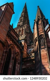 A city cathedral landmark with three spires in England