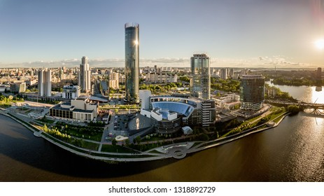 The city center of Ekaterinburg, Skyscrapers behind the city pond. Russia. Aerial Photography