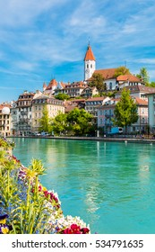 The city center of Thun, Switzerland with view of City Church and Castle Thun.